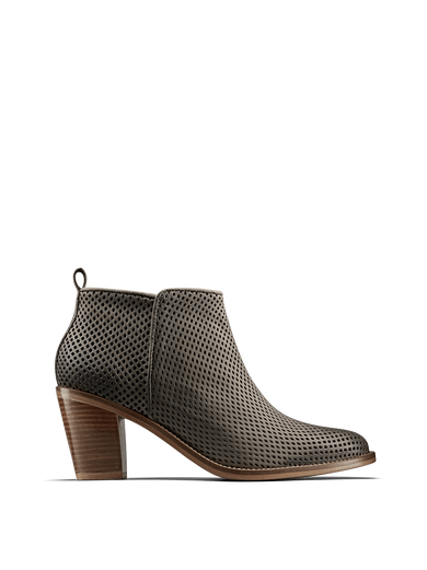 Corsley, a leather boot with a Cuban heel, clean lines and perforation design.
