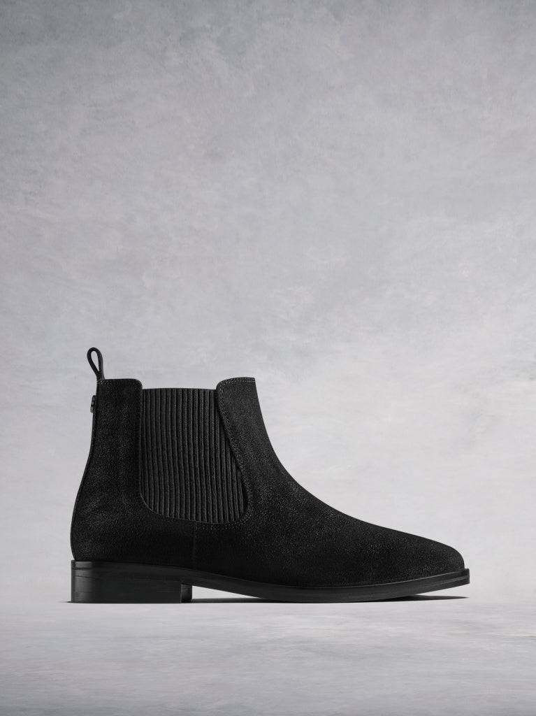 The Darwin, a versatile black suede Chelsea ankle boot with an edge.