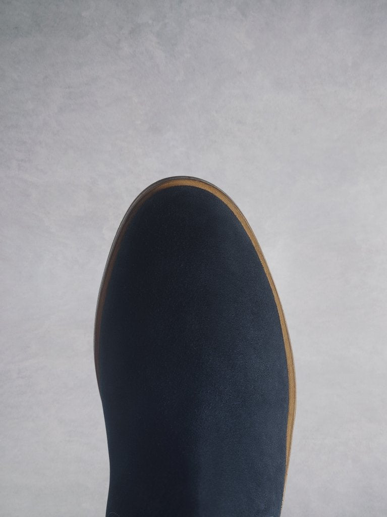 The Darwin navy has a comfortable round toe and a crepe look sole.