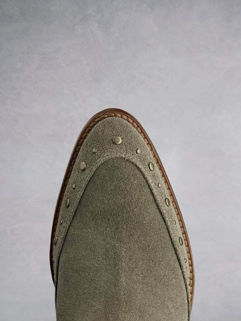 Emilia in khaki suede, with stud detailing that highlights the almond toe shape.