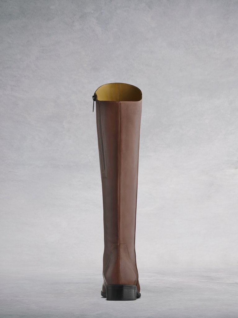 The tan Huntsman has a lower asymmetric cut at the back of the boot.