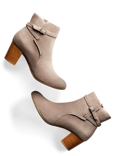 Kelston features a narrow crossover strap with buckle and a mid-height heel.