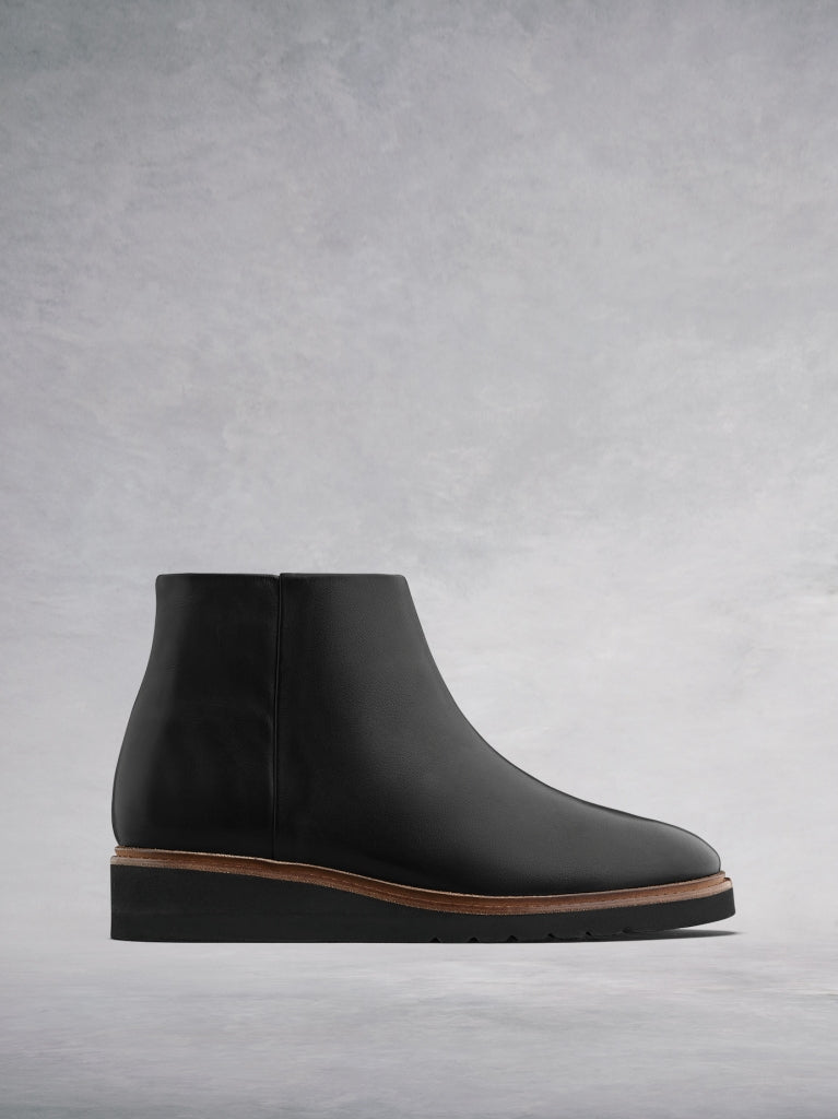 The Kielder, flat slide-on ankle boots in a luxurious black leather.