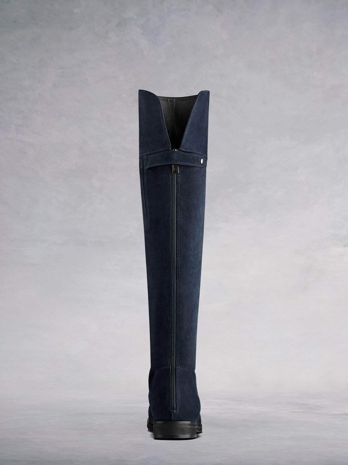 This OTK boot has a subtle full length back zip and a soft leather lining.
