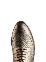 Mullion in gold leather has a flattering almond toe shape and gold waxed laces.