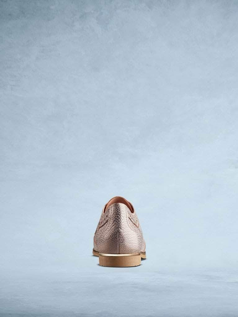 This textured rose gold leather has a contrasting brown sole.
