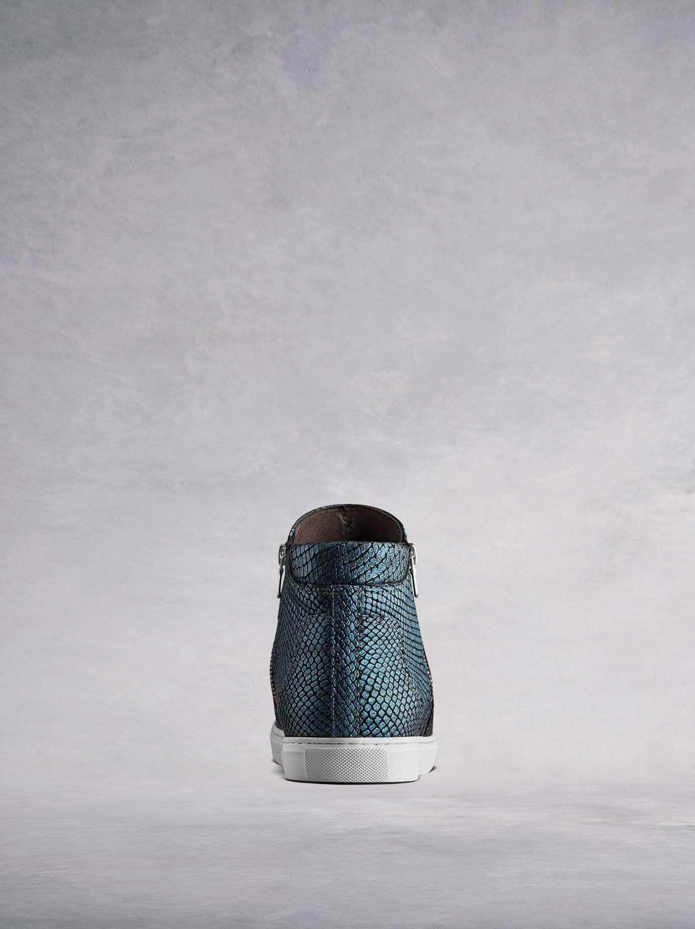 Made from stylish blue snake embossed leather with a contrast white sole.