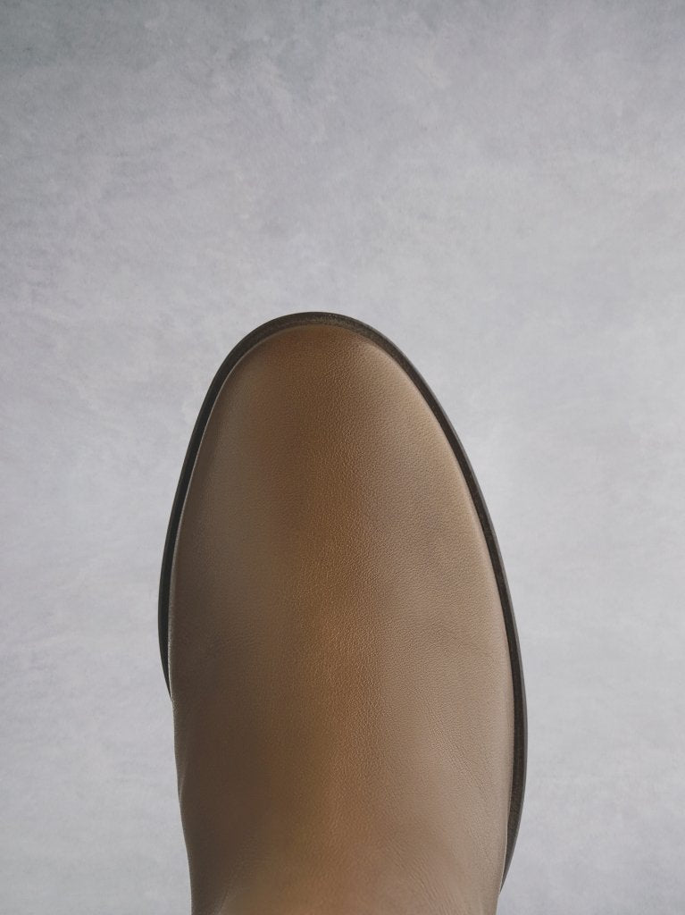 The Siren in tan has a round toe that is both comfortable and practical.