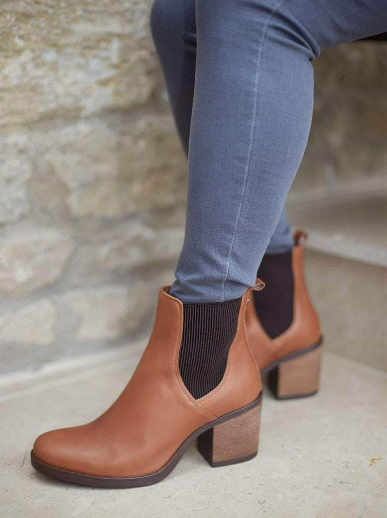 This staple tan ankle boot can be worn with jeans or midi dresses or skirts.