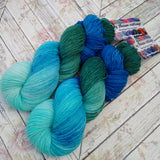 hand dyed yarn sock weight , water greens and blues