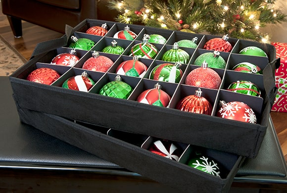 SSanta's Bags Three Tray Ornament Storage Bag with Side Pockets acid free trays removed and sitting on a piano bench