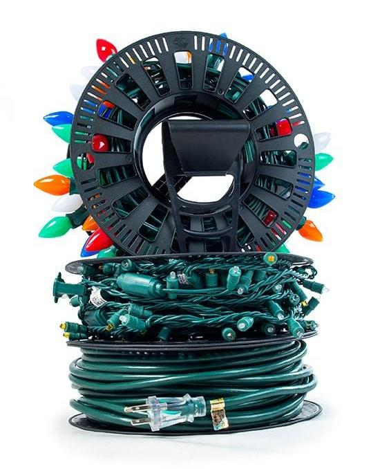Install N Store Light storage reel full of different types of Christmas lights and extension cords.