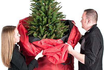 Santa's Bags Upright Christmas Tree Storage Bag - Bag being pull up and over Christmas tree