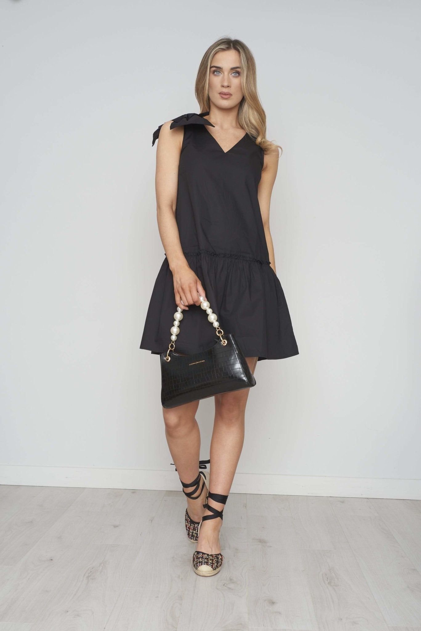 Frankie Peplum Bow Dress In Black - The Walk in Wardrobe