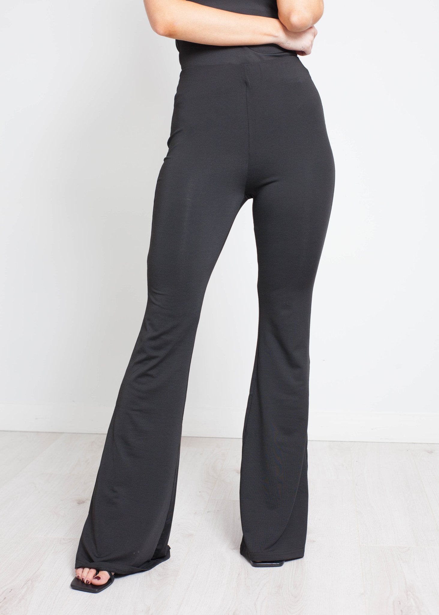 Scarlet Flared Trousers In Black - The Walk in Wardrobe