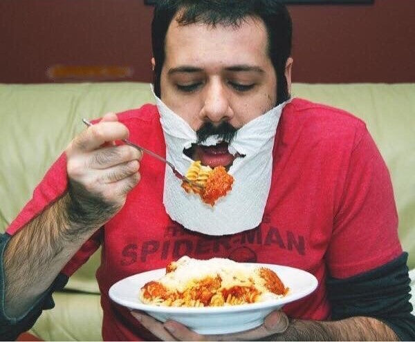 Man eating with a beard
