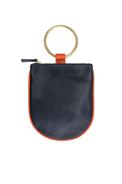 "Ring pouch from Myers Collective's collaboration with Otaat. Cowhide leather pouch, with 3"" ring that slips easily on the wrist. Unlined. Navy body / Brick trim, brass ring."
