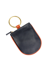Minaudière Wristlet Handbag. Best replacement for classic clutch. Soft leather pouch with brass ring that slips easily on the wrist. Sized to hold your phone and necessities. Unlined.