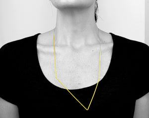 Beautiful, architectural jewelry. Brass and silk.