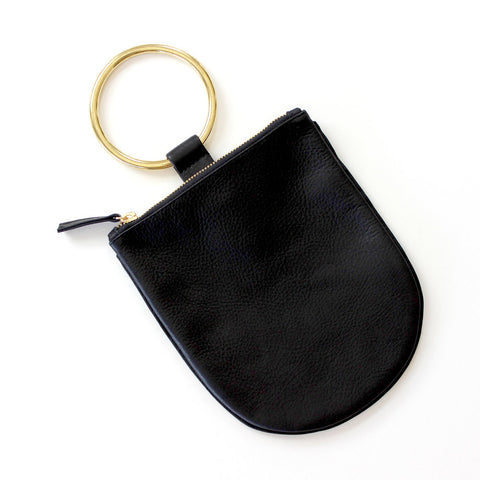 Coolest replacement for classic clutch. Soft leather pouch with brass ring that slips easily on the wrist. Sized to hold your phone and necessities. Unlined.