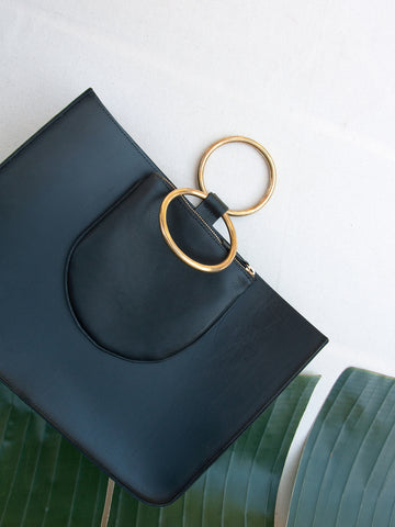 "Otaat Myers Collective leather Ring Tote with zip pouch for phone and keys. 3"" solid brass rings slip easily on the wrist. Detachable optional shoulder strap."