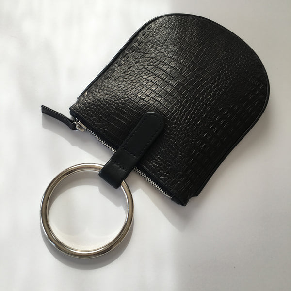 "Ring pouch from Myers Collective's collaboration with Otaat. Embossed cowhide leather pouch, with 3"" nickel ring that slips easily on the wrist. 2-way nickel zipper. Unlined."