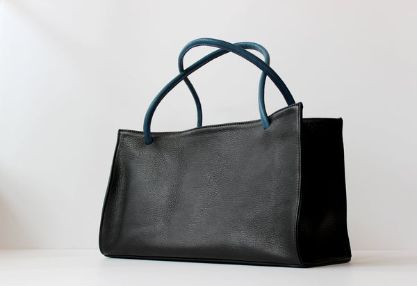 Myers Collective Porter Tote pebbled glovetan leather with contrasting leather straps and interior pockets sized for your sunnies, phone and pens.