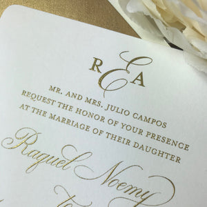 close up of gold thermography printing on wedding invitations