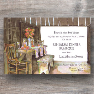 country rustic rehearsal dinner invitations with wooden table inside barn
