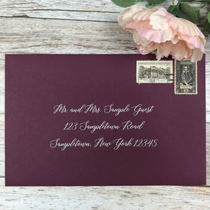 burgundy envelope with guest address white ink