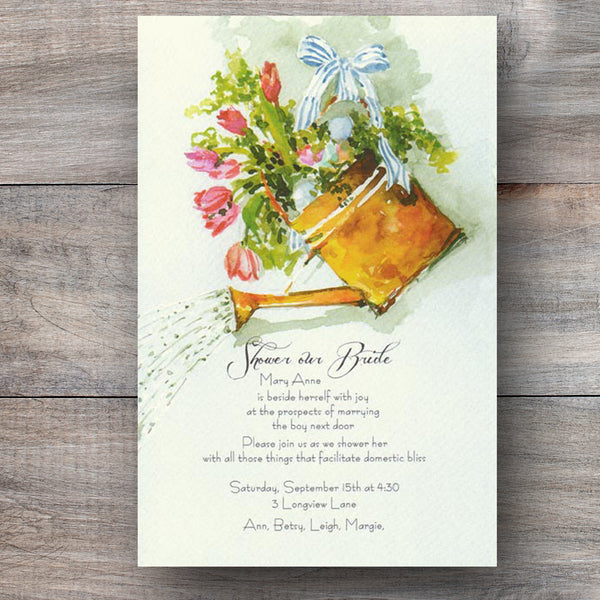 bridal shower invitation with copper can filled with flowers