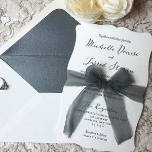 letterpress wedding invitation with dove gray silk ribbon