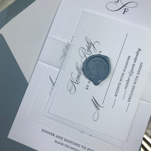 close up of dusty blue letterpress wedding invitation