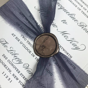 close up of dusty lavender silk ribbon for letterpress wedding invitations