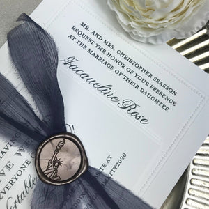 close up of personalized wax seal for letterpress wedding invitations