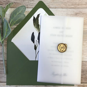 green foliage letterpress wedding invitation with vellum wrap and wax seal