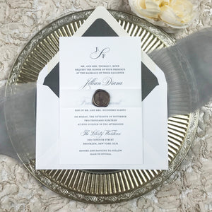 letterpress wedding invitation with belly band and wax seal