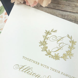 close up of gold thermography printed on white invitation
