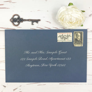 navy and blush letterpress wedding invitation suite outer envelope