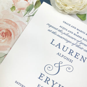 close up of navy and blush letterpress wedding invitations