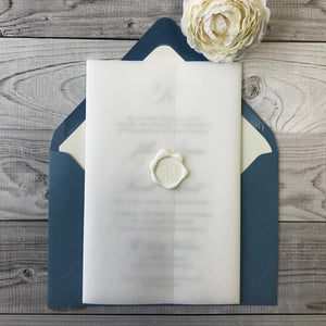 letterpress wedding invitation wrapped with sheer vellum