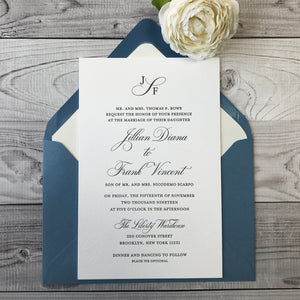 close up of letterpress wedding invitation with new blue envelope