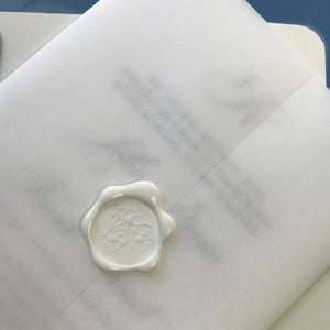 sheer vellum is adhered with a wax seal