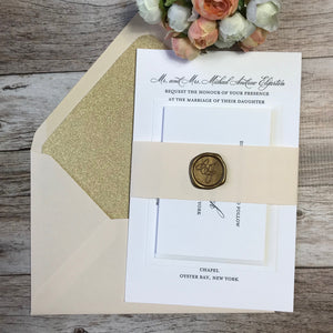 blush and gold letterpress wedding invitations with antique gold wax seal