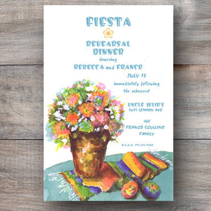 mexican rehearsal dinner invitations with serape table runner and pot of colorful flowers