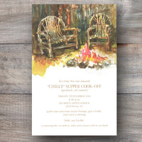 Christmas party invitations with two wooden chairs and crackling bonfire