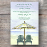 beach wedding invitation with two Adirondack chairs sitting on the beach