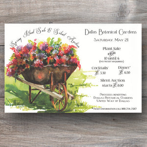 spring invitations with wheelbarrow filled with flowers