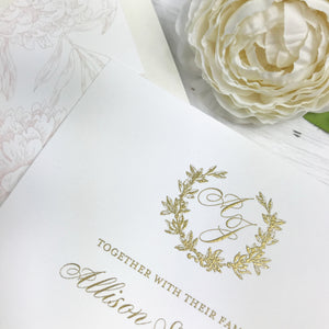 classic white and gold thermography wedding invitation close up