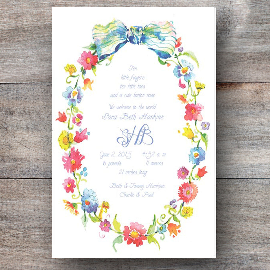 floral invitation with with wreath crafted of wildflowers